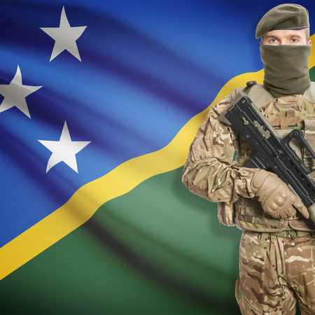 peacemaker: Soldier with machine gun and national flag on background series - Solomon Islands Stock Photo