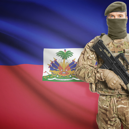 peacemaker: Soldier with machine gun and national flag on background series - Haiti