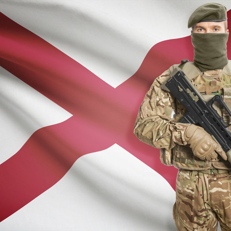 alabama flag: Soldier with machine gun and USA state flag on background series - Alabama
