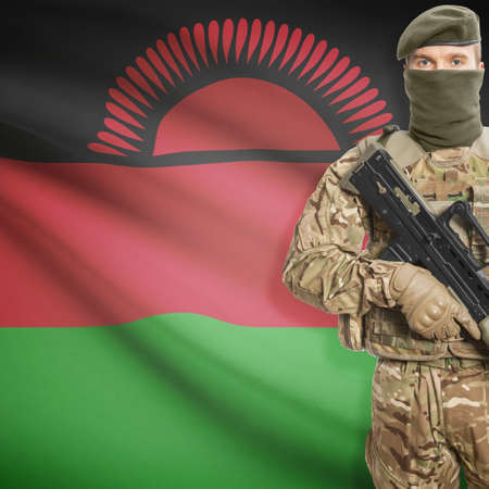 malawian flag: Soldier with machine gun and national flag on background series - Malawi Stock Photo