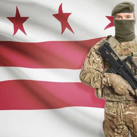 district columbia: Soldier with machine gun and USA state flag on background series - District of Columbia