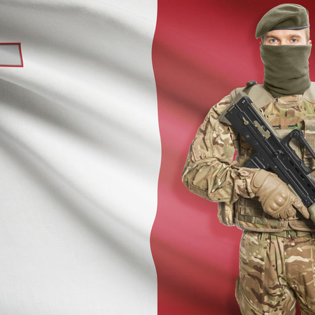 border patrol: Soldier with machine gun and national flag on background series - Malta Stock Photo
