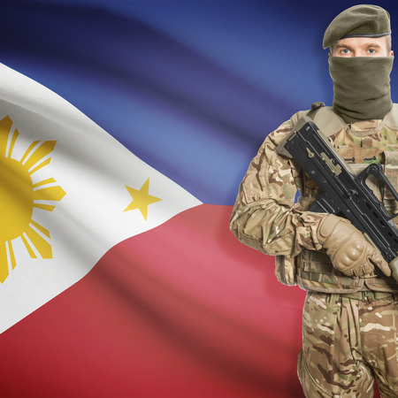 border patrol: Soldier with machine gun and national flag on background series - Philippines