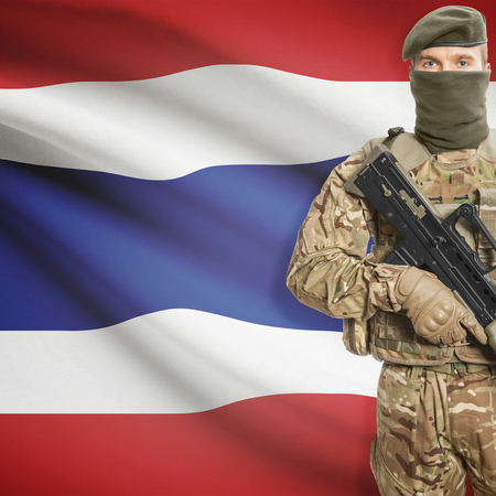 border patrol: Soldier with machine gun and national flag on background series - Thailand