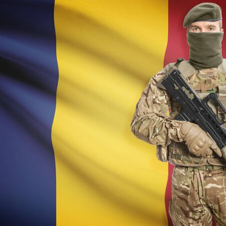 border patrol: Soldier with machine gun and national flag on background series - Romania Stock Photo