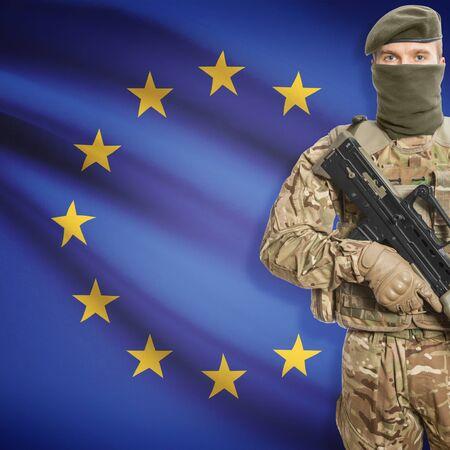 border patrol: Soldier with machine gun and national flag on background series - European Union - EU