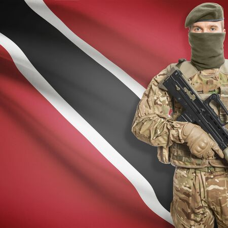 national flag trinidad and tobago: Soldier with machine gun and national flag on background series - Trinidad and Tobago