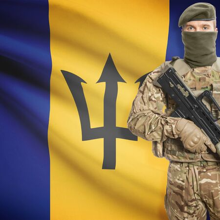 border patrol: Soldier with machine gun and national flag on background series - Barbados Stock Photo