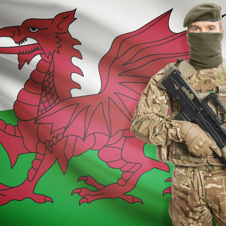 border patrol: Soldier with machine gun and national flag on background series - Wales