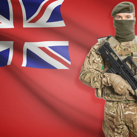 manitoba: Soldier with machine-gun in hands and Canadian province flag on background series - Manitoba