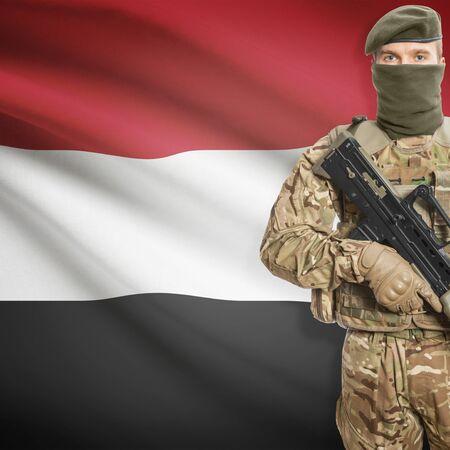 border patrol: Soldier with machine gun and national flag on background series - Yemen