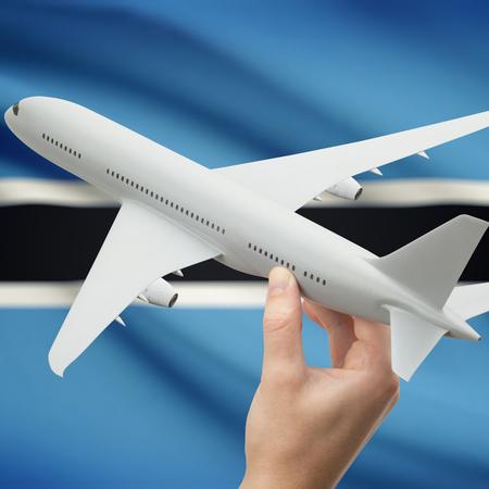 botswanan: Airplane in hand with national flag on background series - Botswana Stock Photo