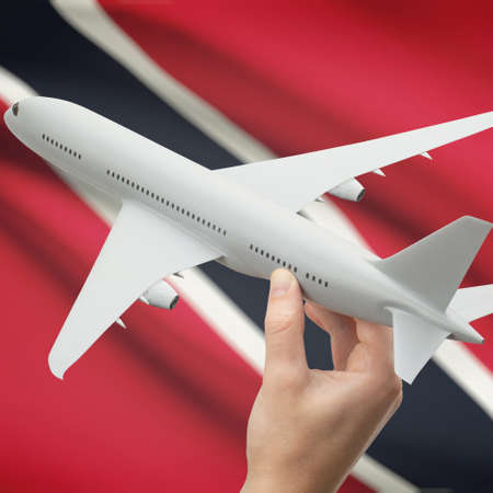 national flag trinidad and tobago: Airplane in hand with national flag on background series - Trinidad and Tobago Stock Photo