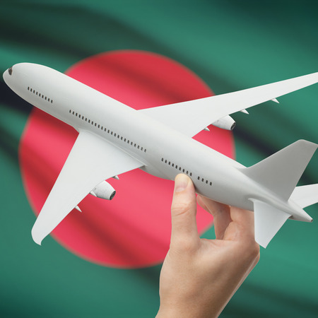 bangladesh: Airplane in hand with national flag on background series - Bangladesh