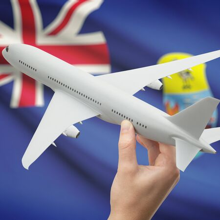 helena: Airplane in hand with national flag on background series - Saint Helena Stock Photo