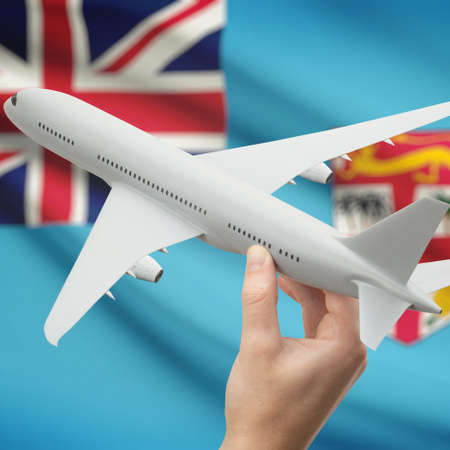 fijian: Airplane in hand with national flag on background series - Fiji Stock Photo