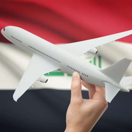 iraqi: Airplane in hand with national flag on background series - Iraq