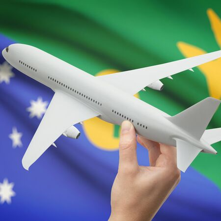 christmas budget: Airplane in hand with national flag on background series - Christmas Island Stock Photo