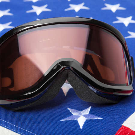 see the usa: Black color winter sport goggles over US flag - studio shot Stock Photo