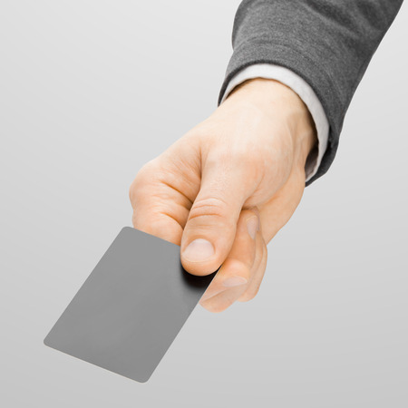 holding close: Close up shoot of male holding in hand grey card