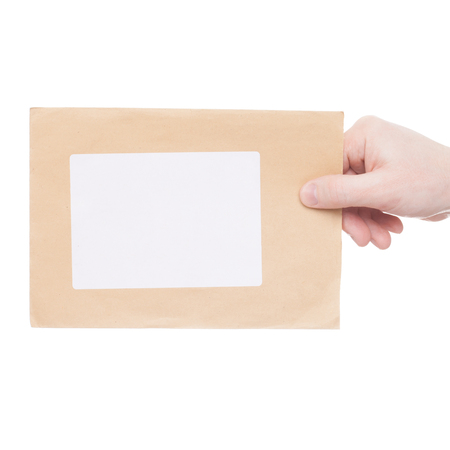 recipient: Concept of delivering a letter to recipient (only one hand and parcel seen) - close up shoot