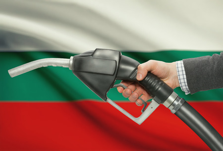 methanol: Fuel pump nozzle in hand with flag on background - Bulgaria Stock Photo