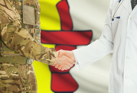 canadian military: Soldier in uniform and doctor shaking hands with Canadian provincies and territories flags on background - Nunavut Stock Photo