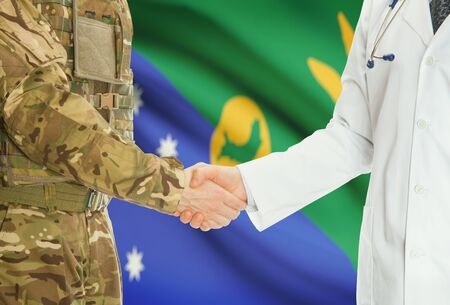 christmas budget: Soldier in uniform and doctor shaking hands with national flag on background - Christmas Island