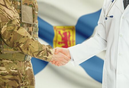 american hero: Soldier in uniform and doctor shaking hands with Canadian provincies and territories flags on background - Nova Scotia