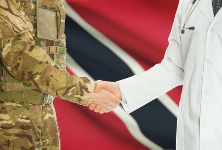national flag trinidad and tobago: Soldier in uniform and doctor shaking hands with national flag on background - Trinidad and Tobago