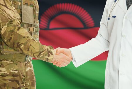 malawian flag: Soldier in uniform and doctor shaking hands with national flag on background - Malawi