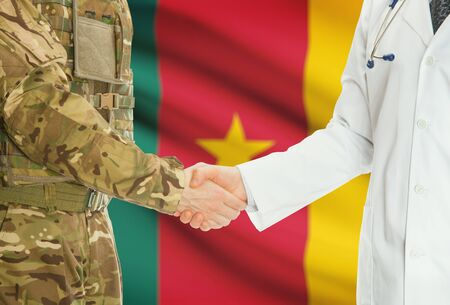 cameroonian: Soldier in uniform and doctor shaking hands with national flag on background - Cameroon