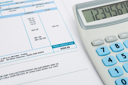 utility payments: Unpaid utility bill and calculator over it series