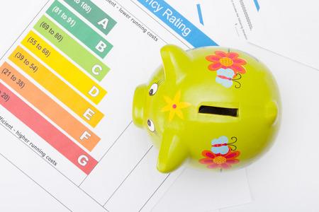piggybank: Energy efficiency chart and piggybank - studio shot from top