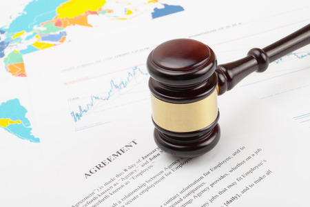 international criminal court: Wooden judges gavel over agreement document - close up studio shot Stock Photo