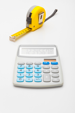 architectural studies: Measurement and calculating instruments - yellow ruler and calculator