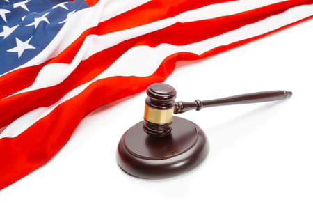 international criminal court: Wooden judge gavel near flag of Unites States of America