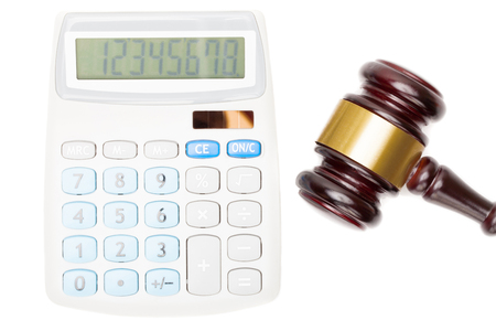 criminal case: Judges gavel near calculator - close up studio shot Stock Photo