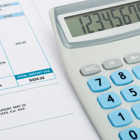studio shots: Series of close up studio shots of unpaid utility bill and calculator over it
