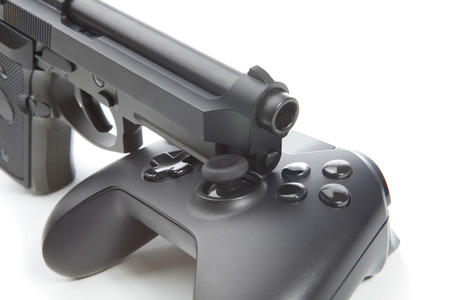 users video: Game controller with real handgun near it Stock Photo