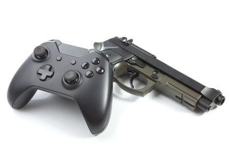 users video: Game controller with real handgun near it - virtual and real life concept