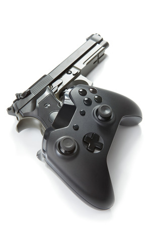 users video: Virtual and real life concept - video game controller with metal handgun under it