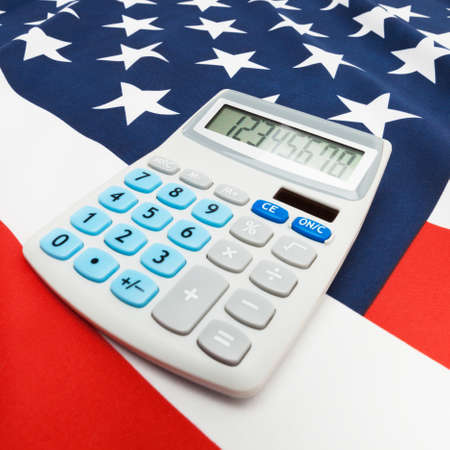 cost estimate: Part of close up studio shots series of national flags with calculator over it - United States