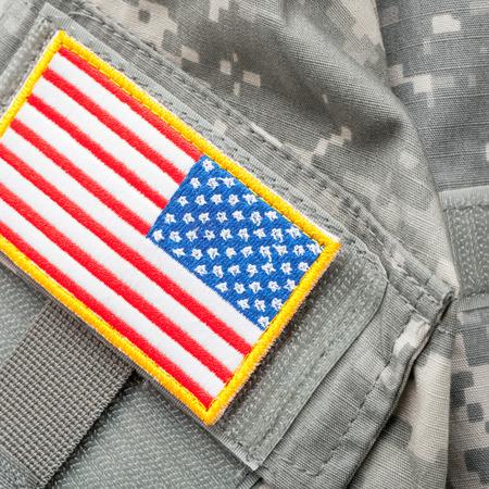 solders: USA flag shoulder patch on solders uniform - close up shot