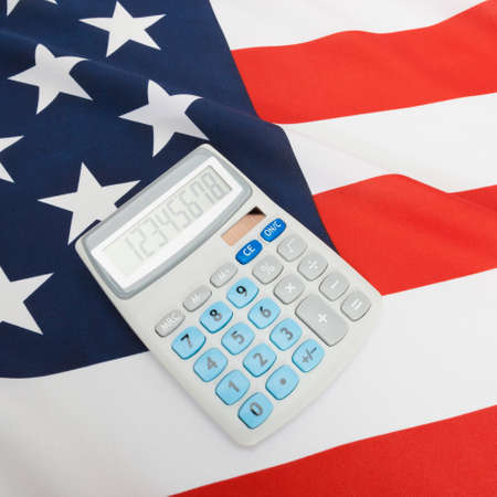 cost estimate: Part of close up studio shots series of flags with calculator over it - USA
