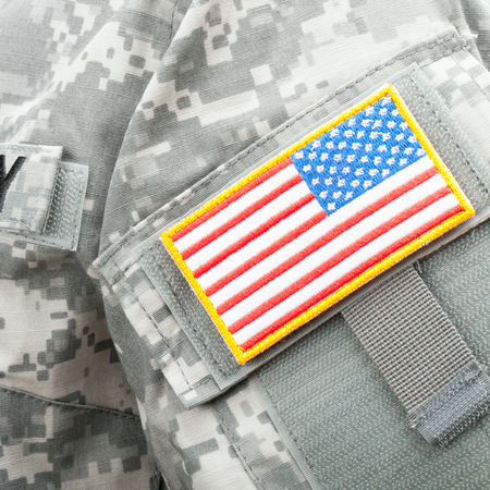 solders: Close up shot of USA flag shoulder patch on solders uniform