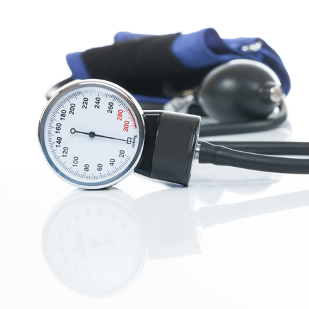 tonometer: Close up studio shot of a blood pressure measuring medical equipment on white - a tonometer Stock Photo
