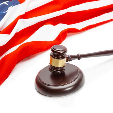 unites: Close up shot of a judge gavel near flag of Unites States of America Stock Photo
