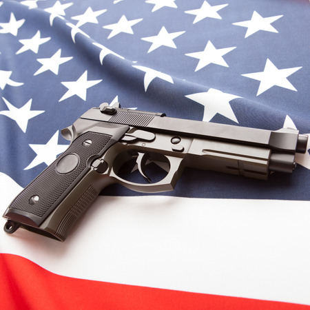 Part of national flags with hand gun over it series - United States of America Stock Photo