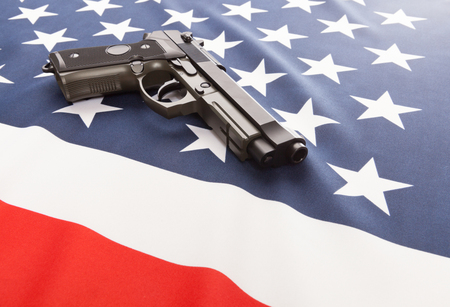 Part of national flag with a hand gun over it series - USA